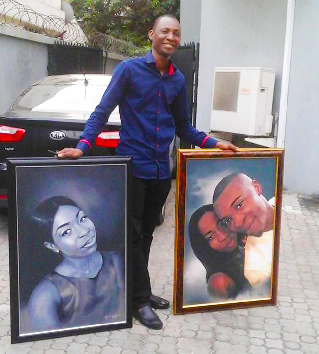 ayodeji ayeola standing with his portrait painting in lekki phase 1 Book 24inches by 36inches portrait painting. price N55,000